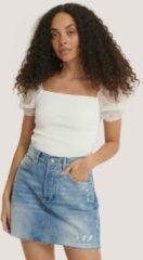 MANGO Monica mini spijkerrok met gerafelde zoom