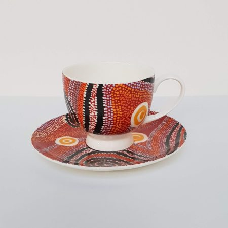 Afbeelding van Oranje Alperstein Designs Design kop en schotel - Otto Jungarrayi Sims - Aboriginal collectie