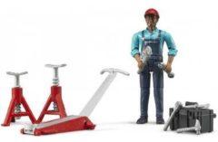 Grijze Bruder garage werker met accessoires.