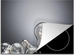 KitchenYeah Luxe inductie beschermer Gloeilampen - 70x52 cm - Stapel gloeilampen op een grijze achtergrond - afdekplaat voor kookplaat - 3mm dik inductie bescherming