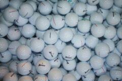 Witte Golfballen gebruikt/lakeballs Srixon 25 stuks in meshbag