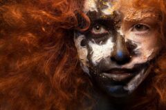 Onlinecanvas Red haired woman with face art and creative make up. Curly hair style. Black and white face art. Fantasy painted girl. Masquerade - Modern Art Canvas - Horizontal - 243473584 - 50*40 Horizontal