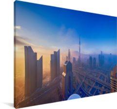 MuchoWow Een fantastische invalshoek van het zonlicht op de stad Dubai Canvas 120x80 cm - Foto print op Canvas schilderij (Wanddecoratie woonkamer / slaapkamer) / Europese steden Canvas Schilderijen