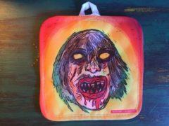 Rode Solijn Doodskoppen pannenlap - Skull pannenlappen griezel gezicht